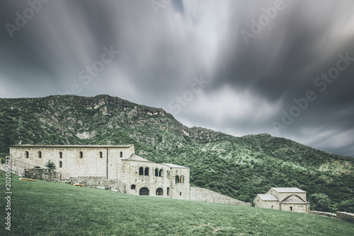 church in  mountain landscape - spring mood - desaturated style image - 202005623