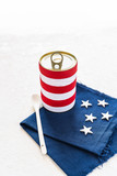 white and red striped tin filled with tomato sauce and white stars on blue cloth in american style - 202040068