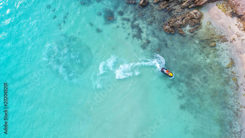 People are playing jet ski at sea during the holidays. Aerial view and top view. - 202048201