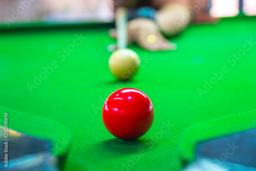 Snooker is aim the cue ball focus on yellow ball on the table - 202048648