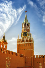 The famous Spasskaya tower of Moscow Kremlin, Russia. Spasskaya tower on the blue sky background in the sunlight.