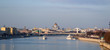 Panoramic view of Moskva river with river buses from Novoandreevskiy Bridge. Krymsky bridge and Cathedral of Christ the Savior on the horizon. Urban landscape on spring evening in Moscow, Russia