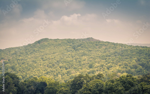 Mountainous terrain and cloudy sky
