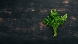 Parsley. Top view. On a black wooden background. Copy space. - 202075271