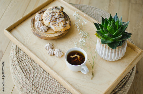 Wall mural Breakfast in bed, fragrant tea and croissants for breakfast