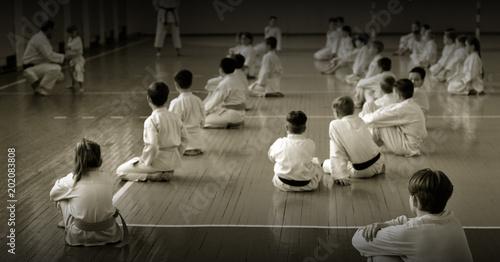 Kids training on karate-do. Black and white.