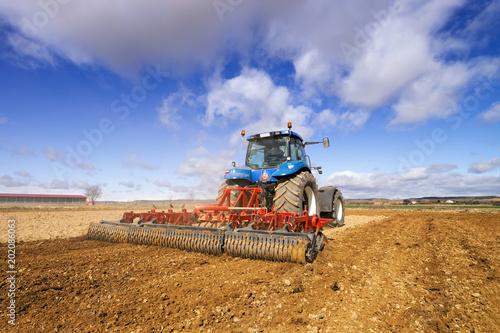 Aluminium Trekker Tractor modern , farm equipment in field
