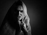 Anger man covered by fabric. Black and white