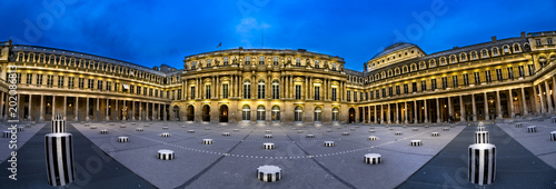 Paris, France - 05 May, 2017: Panoramic view at twilight of in the courtyard of Palais Royal with Columns of Buren in Paris, France - 202086813