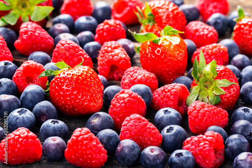 Fruits background, strawberries, raspberries, blueberries