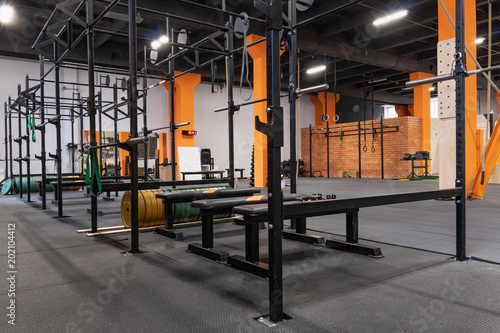 Poster Interior of gym for fitness training with horizontal bar and barbells