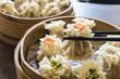 Enjoying traditional Chinese dumpling called Shumai
