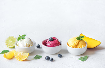 Various fruit and berries ice creams