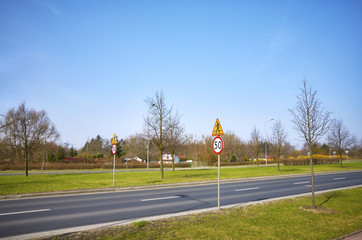 Road with 50 km per hour speed limit signs.
