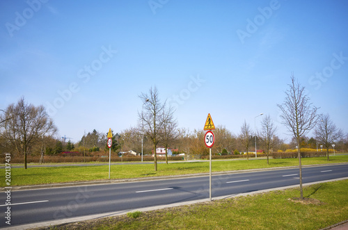 Road with 50 km per hour speed limit signs. - 202137431