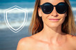 Quadro portrait of the beautiful woman in a swimsuit and sunglasses on the beach. concept of protection and prevention of cancer on vacation at the beach. spf, sunscreen from ultraviolet rays