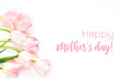 Happy mother's day greeting card with tender pink tulips on white background. Top view.