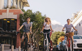 Group of friends cycling in the city - 202158663
