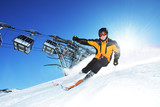 Skier in mountains, prepared piste and sunny day - 202184427