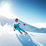 Skier in mountains, prepared piste and sunny day - 202184434