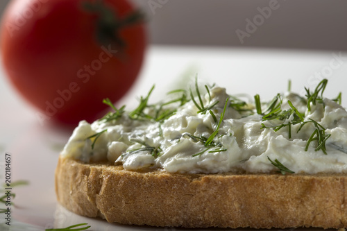 Fototapeta Open sandwich with toast and homande cheese cream with fresh dill