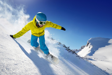 Skier in the freeride - mountains at sunny day.