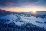 Amazing winter landscape image. Sunset over freezing village in winter / snowy nature. Mountains in winter conditions. - 202194671