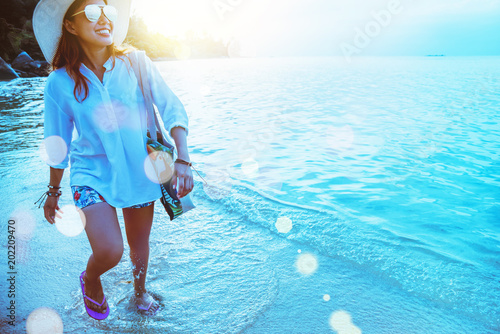 Plexiglas Turkoois Asian woman travel nature. Travel relax. Walking on the beach. In the summer