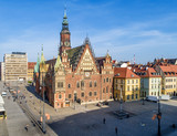 Old Gothic city hall in Wroclaw (Breslau) in Poland, built in 14th century and historic market square (Rynek). Aerial view. Early morning