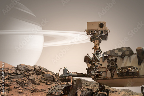 Curiosity Mars Rover exploring the surface of red planet. Elements of this image furnished by NASA. - 202232849