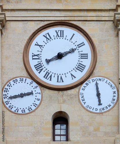 Valletta, Malta, St Johns cathedral clocks on sandstone facade Photo by Rawf8