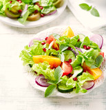 Red and yellow fresh tomato salad with  pomegranate seeds - 202250201
