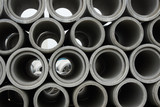 Stacked concrete pipes at concrete factory warehouse - 202251610