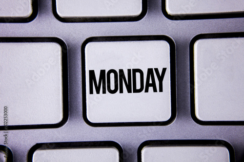 Word writing text Monday. Business concept for First day of the week Back to work Weekend is over Wakeup Early written on White Keyboard Key with copy space. Top view.
