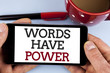 Word writing text Words Have Power. Business concept for Statements you say have the capacity to change your reality written on Mobile Phone Screen holding by man on the plain background Cup Marker
