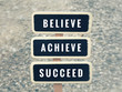Motivational and inspirational quote - Believe, achieve, succeed. With vintage styled background.