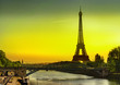 Leinwanddruck Bild - The Eiffel Tower and Cygnes bridge over river Seine at sunrise in Paris, France