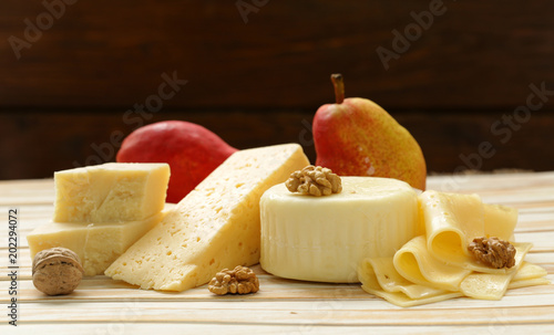 Fototapeta fresh natural assorted cheese board with aromatic pears
