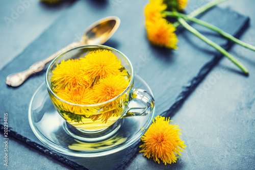 Cup of dandelion tea on slate board