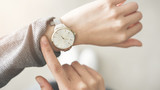 Woman checking time her watch - 202295238