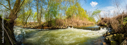 Plexiglas Pistache Landscape in spring with river and trees