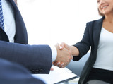 Close-up of two business people shaking hands - 202301670