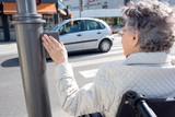 senior woman crossing road