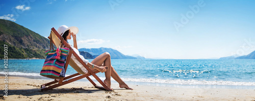 obraz PCV Woman Enjoying Sunbathing at Beach
