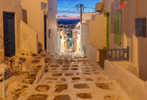 Greece. Mykonos. The old narrow street at sunset.