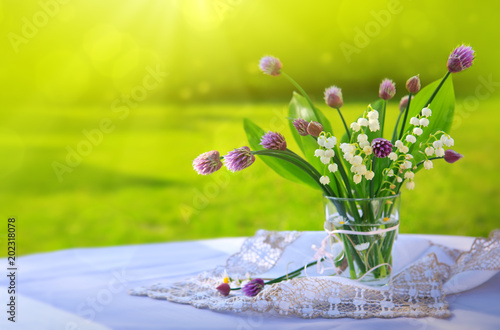 Fotobehang Lelietjes van dalen Lily of the valley bouquet in glas vase.