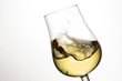 Quadro wave of white wine in a tilted glass