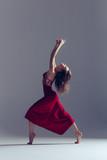 Young beautiful ballerina is posing in studio - 202342426