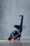 Young beautiful male dancer posing in studio - 202345651