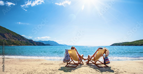 Happy couple relaxing on the beach - 202353028